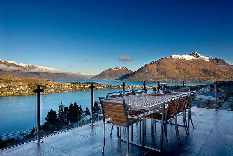 outdoor dining and entertaining with panoramic lake views