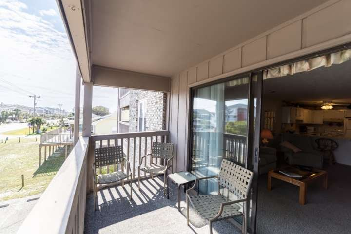 Enjoy morning coffee or evening beverages on this balcony.