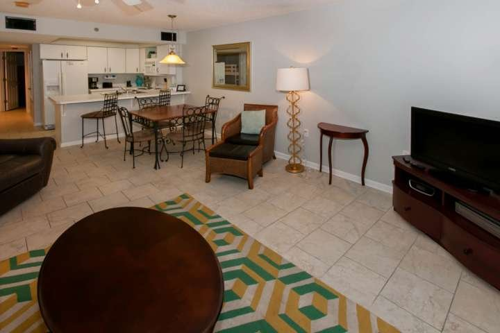Tiled great room with dining table for 4 and breakfast bar for 2