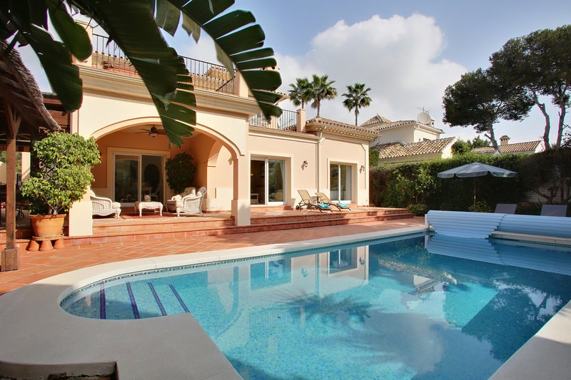 South facing villa with private heated pool and garden.