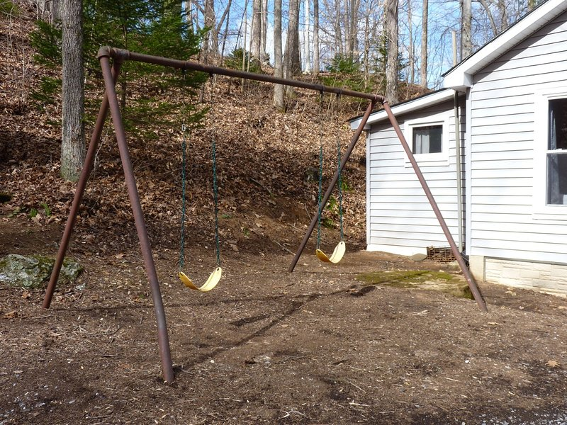 A Swing Set for Kids & Adults to Enjoy Swinging by the Creek