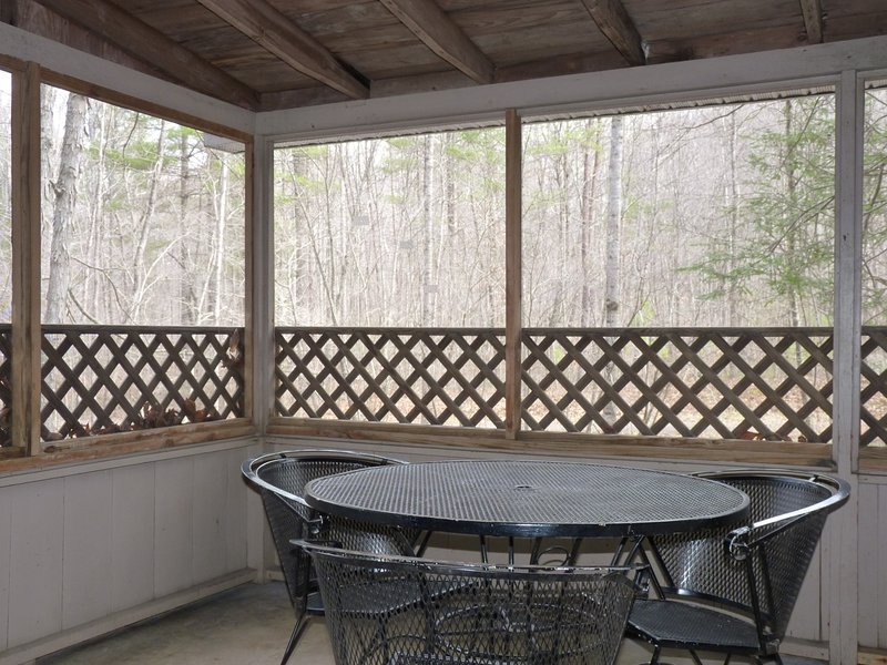 A Nice Little Dinette Table on the Screened In Porch Overlooking the Creek