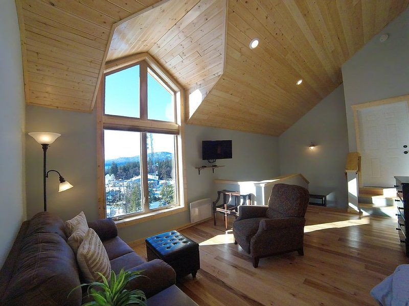 Living area with great view of water and mountains