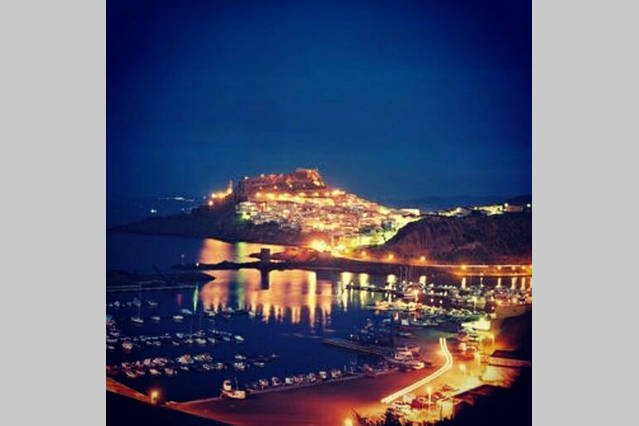 The port and the town of Castelsardo at night.