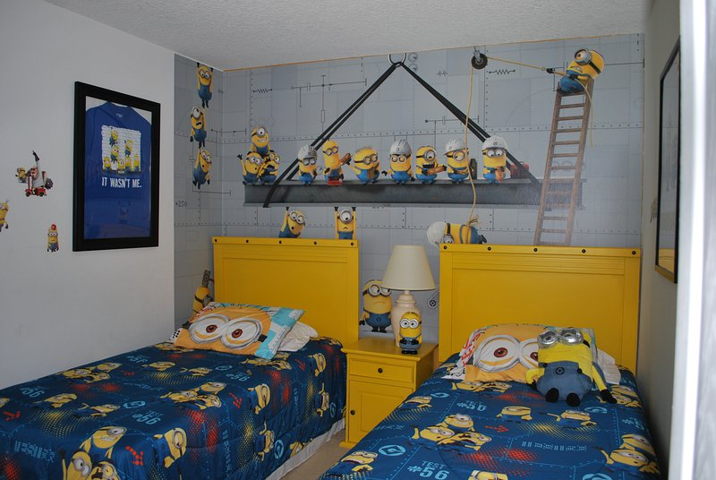 Despicable Me Minion Themed room with 2 twin beds and a TV