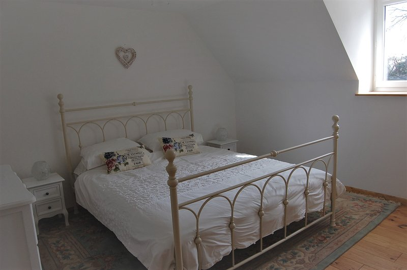 Main bedroom with large brass bed