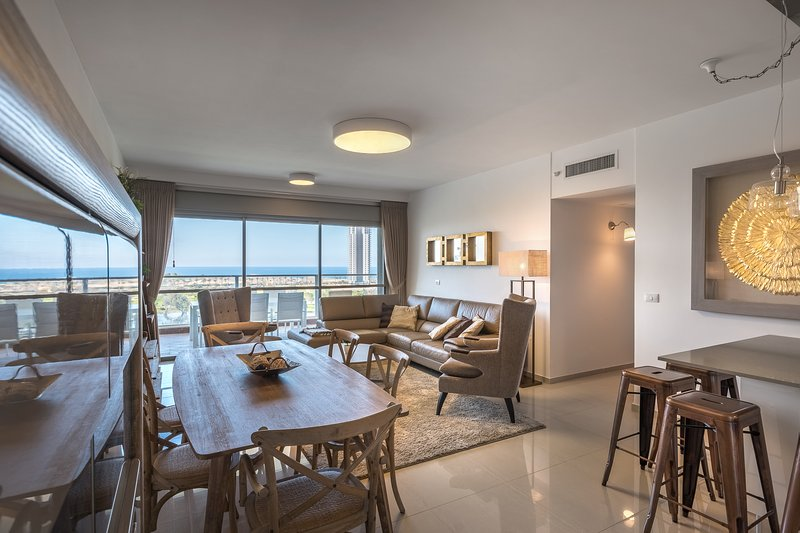 Dining and living area with park and sea view