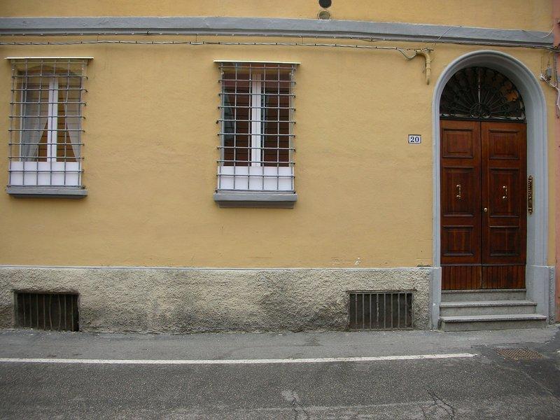 The main door with the 2 windows of the bedroom.