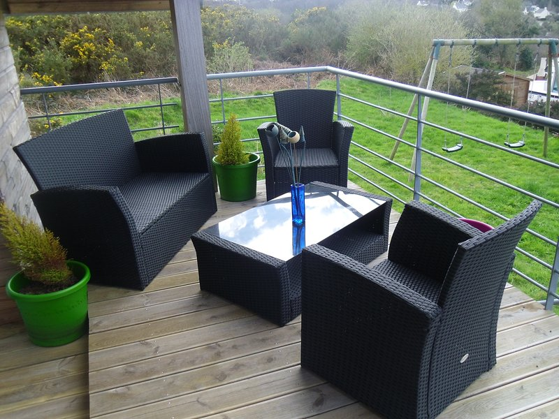 garden furniture on the panoramic terrace on the sea