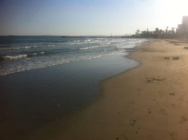 Sandy Beach front de mer