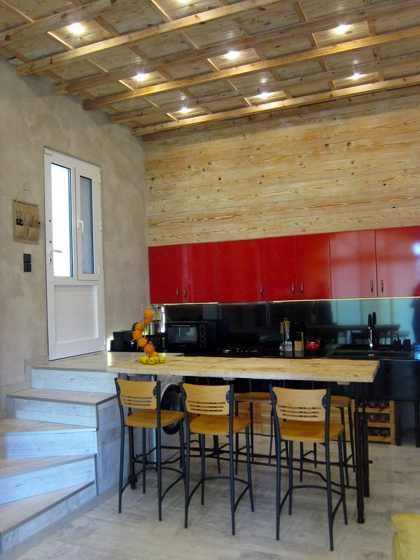 Industrial design kitchen with natural handmade wood and iron fully equipment