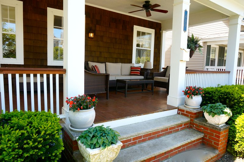 The front porch catches ocean breezes and is a great place for family gatherings.
