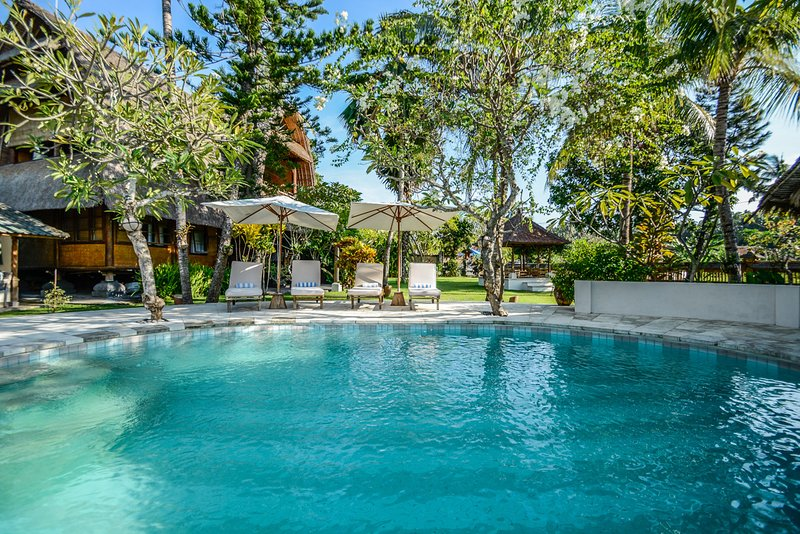 Ocean breezes and tropical gardens surround pool area