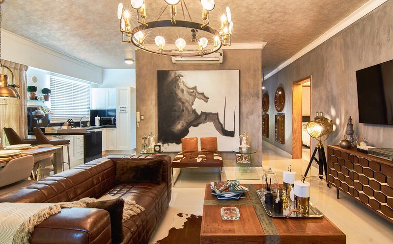 Spacious Livingroom with an open Kitchen, Spacious Balcony with stunning city and partial ocean view
