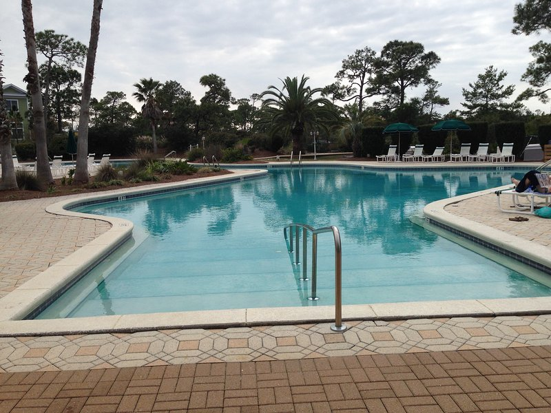 Huge Resort Village pool, located inside Resort Village Property, includes a hot tub and  clubhouse.