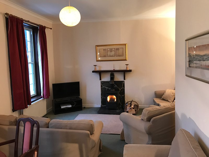 Living Room with sat tv and wood burner