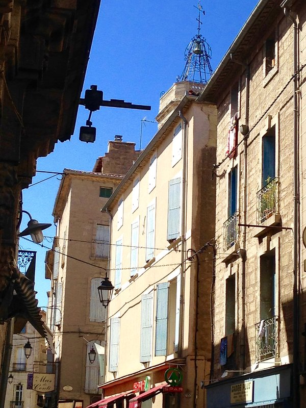 The building is located in the heart of Pezenas, steps from all amenities.