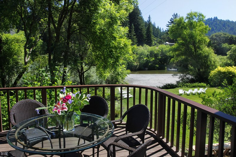 Welcome to Riverwood Cottage! Deck and lawn with beach and river beyond
