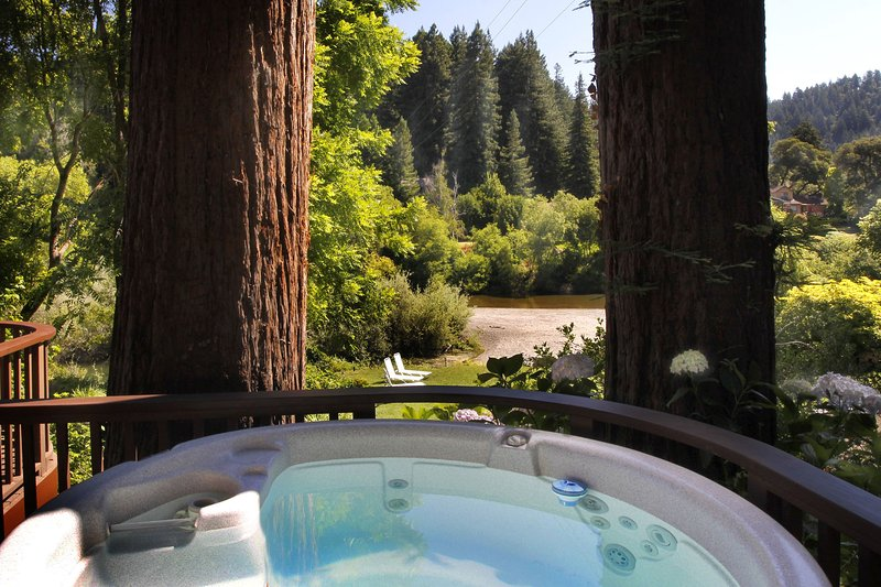 Hot tub on deck, with views of lawn and river