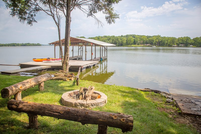 Lake View. Private dock w/ swim platform. Firepit. not shown paddle boat free to use.