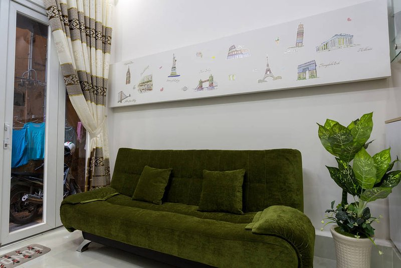 Ground floor with aircon - living room with Sofa Bed convertible