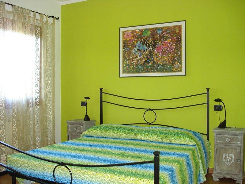 Appartamento padronale in villa 68 posti con ampio giardino privato, holiday rental in Gualdo a Capoliveri