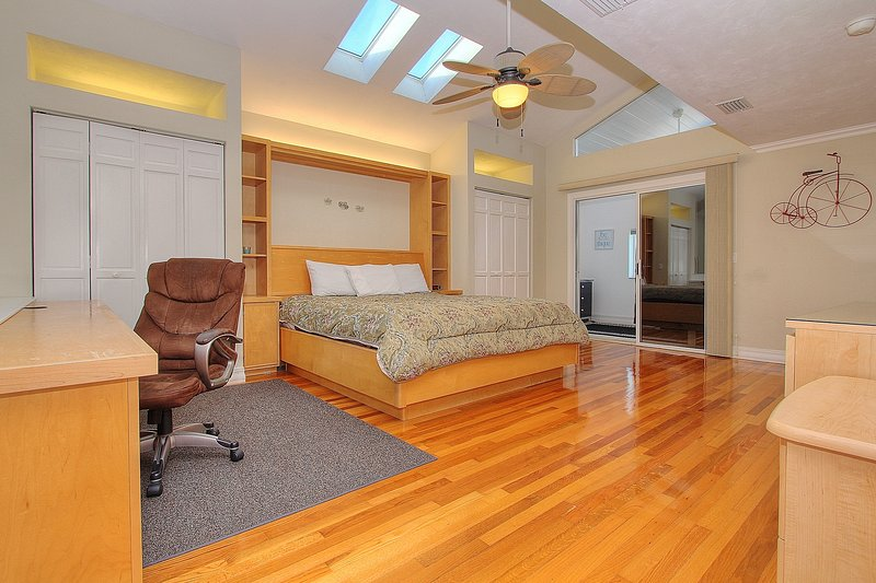 Master with King size bed, skylights and flat screen TV at Beach House 1703