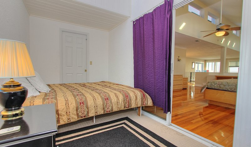 Bedroom with king size bed located just off master bedroom at Beach House 1703
