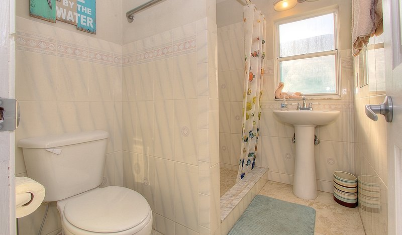 Tile shower & lots of natural light help guests get ready or another day of fun