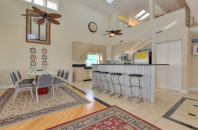 Modern kitchen with stainless steel bar with seating for 16 at Beach House 1703