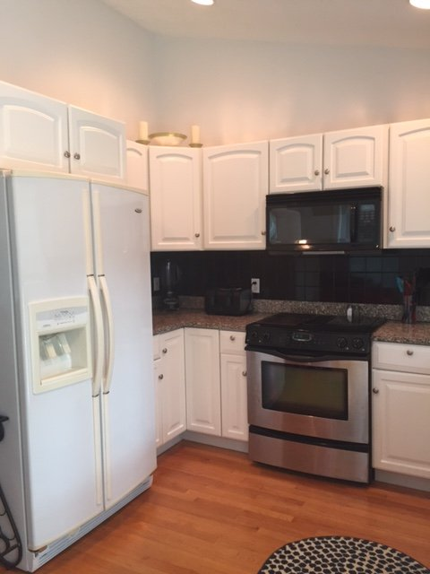 Granite counter tops, full size refrigerator, dishwasher and double sink.