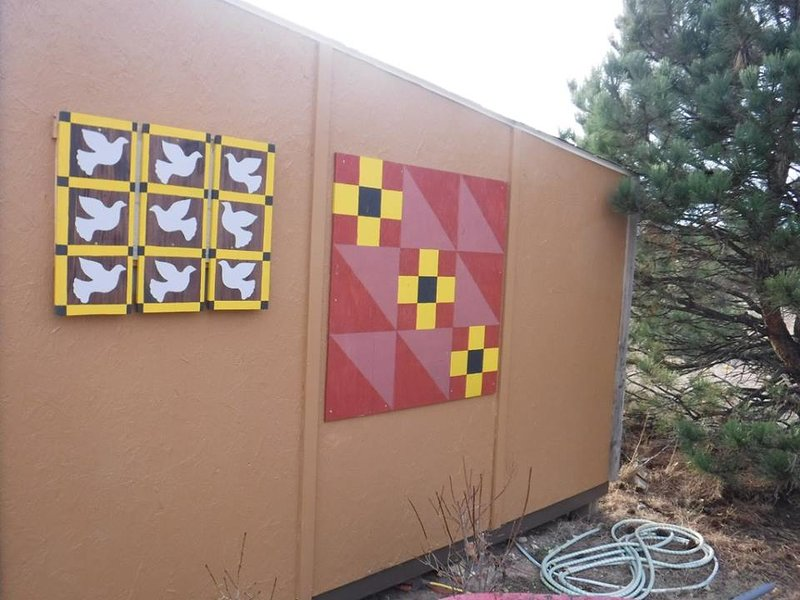Barn quilts are found in various places on our acreage, including on the side of the cabin.