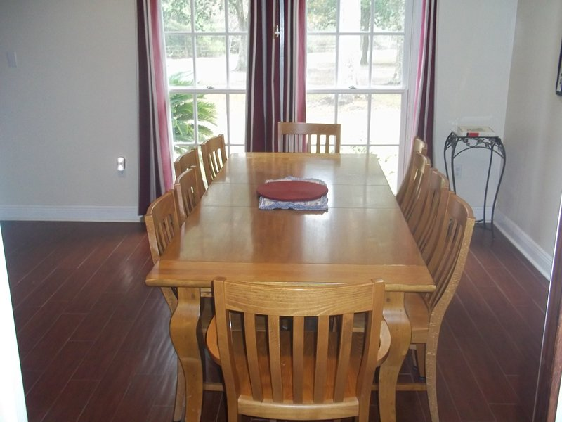 Dining room table for ten. Extra leaf can be added for a little more space.