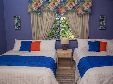 Bedroom 2  2 queen beds garden view
