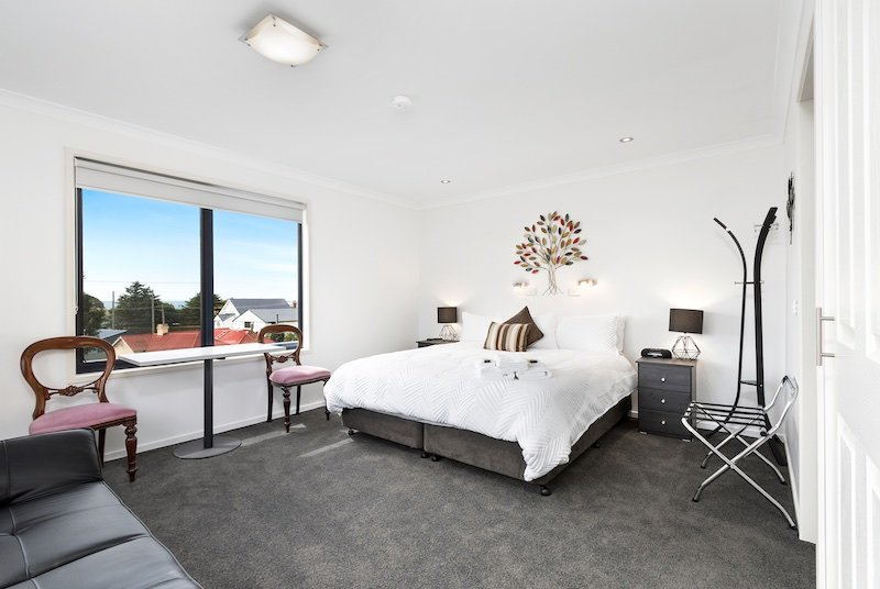 Large comfortable room with lots of natural light and wonderful ocean view