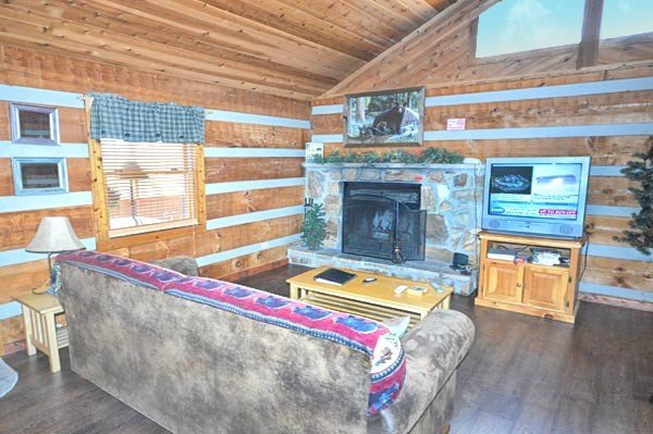 Very open Living area w/TV and Wood Fireplace