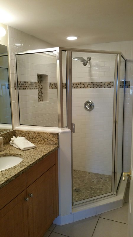 New Walk In Shower in 2nd Bedroom w/rain shower head & massage shower flooring