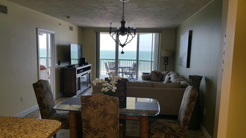 Direct Oceanfront living room, dining room and kitchen.