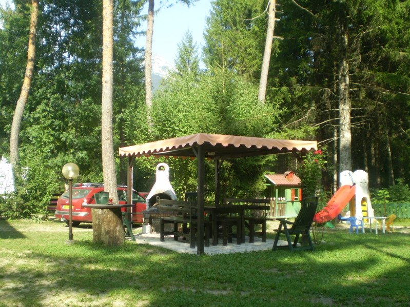 The private area available to the 'apartment with outdoor furniture and barbecue