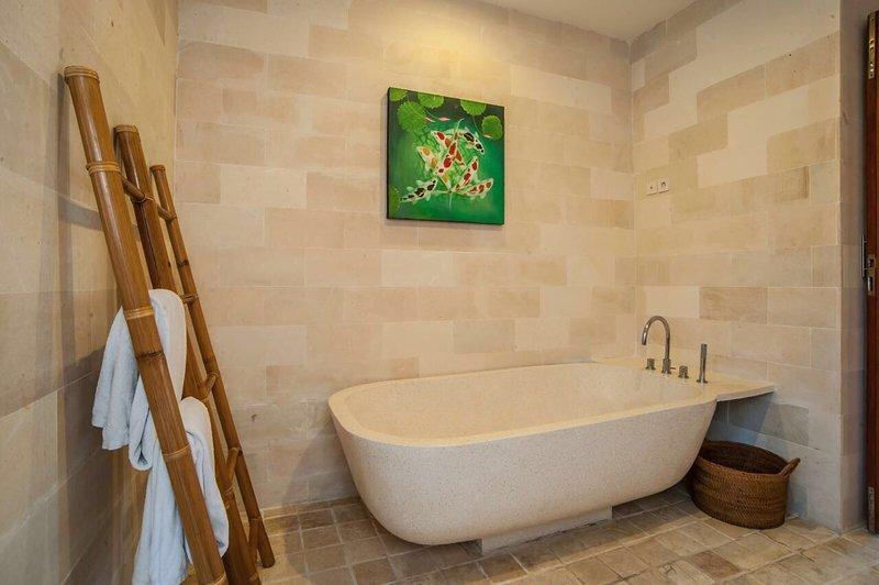 En-suite bathroom with separate bath & shower