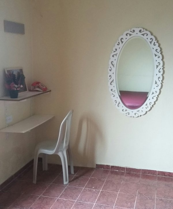Desk and mirror located inside the room to sleep.