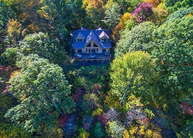 Aerial View: Beginning of fall color above Cabin in the Clouds