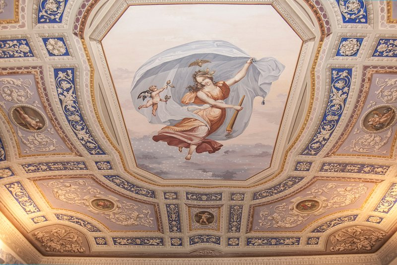 The frescoed ceiling of the living room