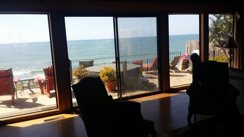 Living room to oceanfront facing the patio, to left is the deck out of picture