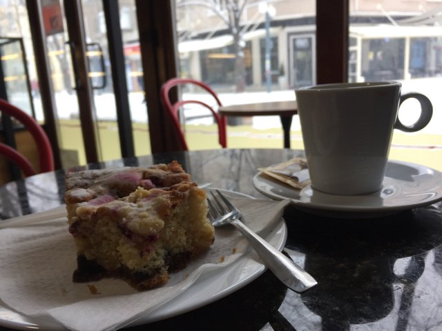 relaxing in one of the many Cafe's with some cake