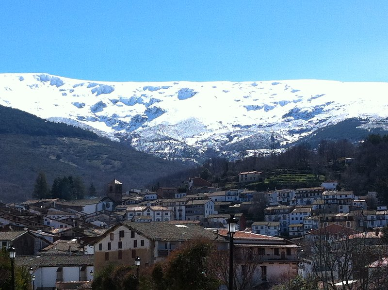 View Candelario with snow in the mountains
