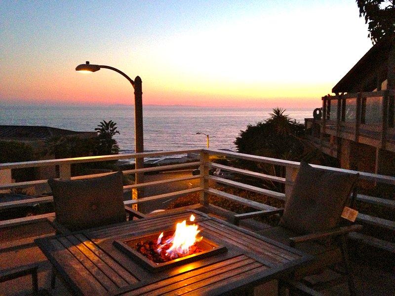 De patio waar u kunt zien en de golven over het rif te horen en genieten van de zonsondergang