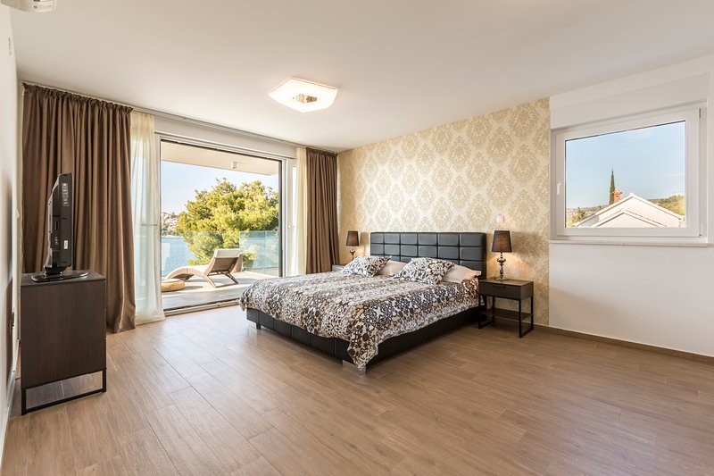 bedroom 4 with terrace and sea view