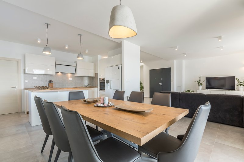 Kitchen and dinning room overlooking iiving room