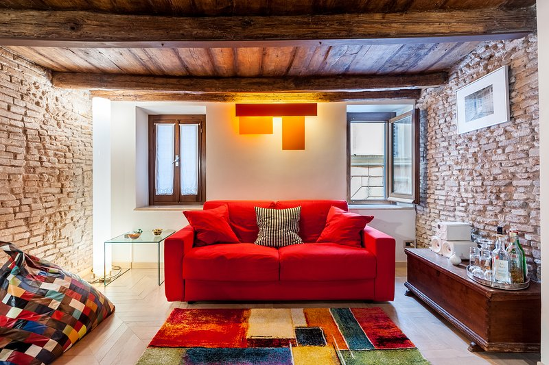 The red sofa converts in a comfortable double bed